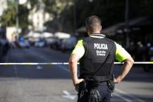 A police officer stands by a cordoned off street after a van crashed into pedestrians near the Las Ramblas avenue in central Bar