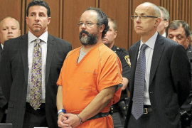 File photo of Castro standing between attorneys as his sentence is read to him by the judge in the courtroom in Cleveland