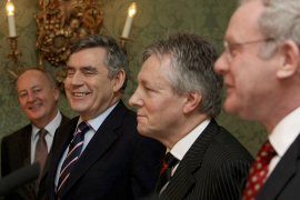 Britain's Northern Ireland Secretary, Woodward, Prime Minister Brown, DUP leader Robinson and Sinn Fein's McGuinness attend a ne