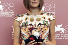 "Actress Knightley holds toy given to her by co-star Mortensen at a photocall for their film ""A Dangerous Method"" which is in com"